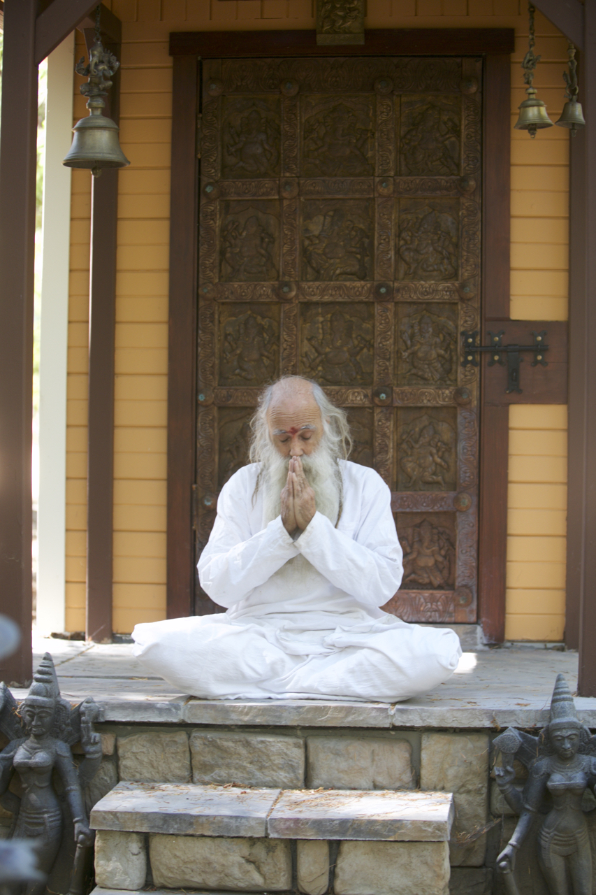 1587673011505_Swami-meditaing-at-Mukambika-temple-by-Amy-Carr.jpg